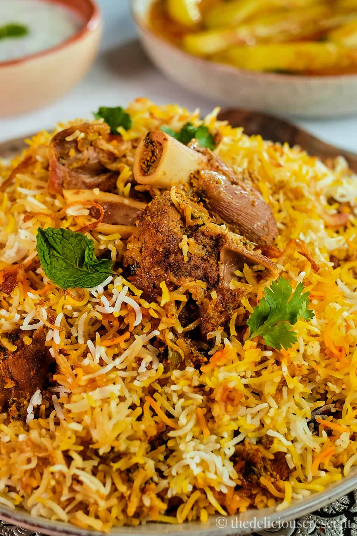Chunks of marinated lamb on top of a mound of spiced Indian rice.