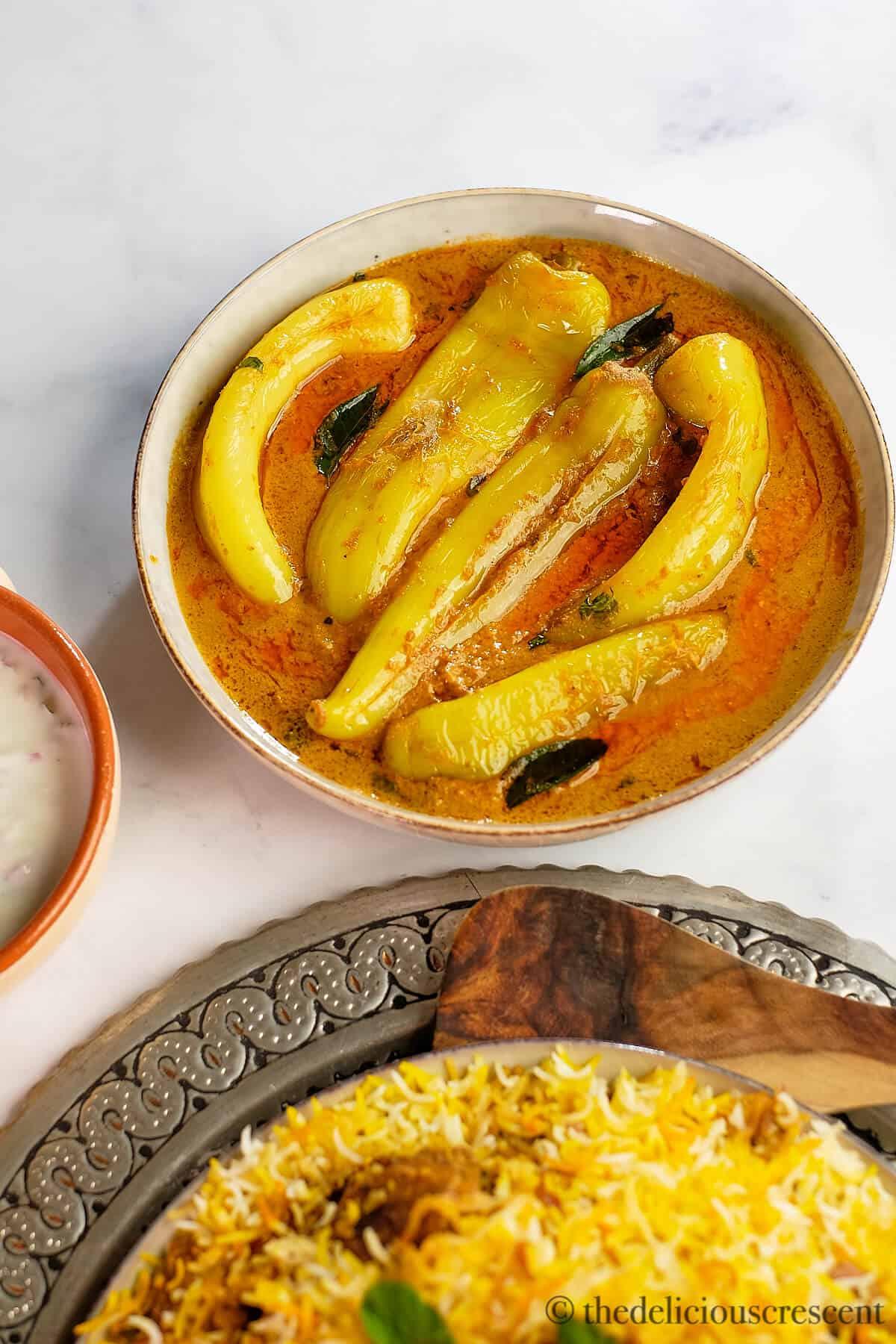 Mirchi ka salan served with biryani.