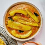 Close up view of mirchi ka salan served in a dish.