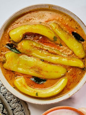 Close up view of mirchi ka salan served in a dish.