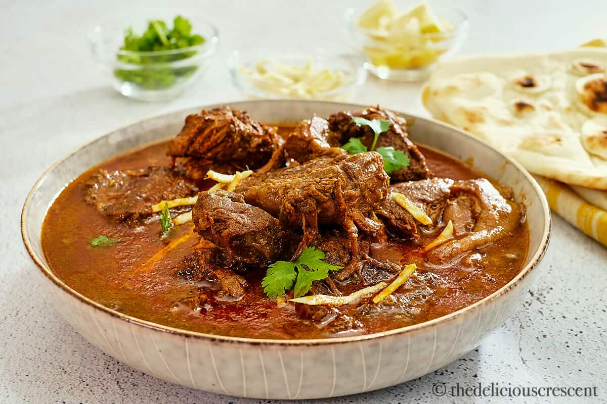 Front view of Nihari beef stew with ginger and cilantro on top.