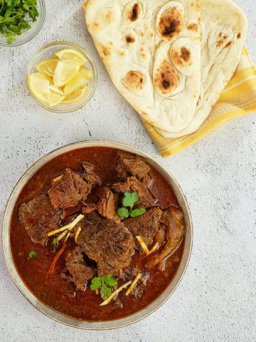 Close up view of Indian beef curry with naan bread.