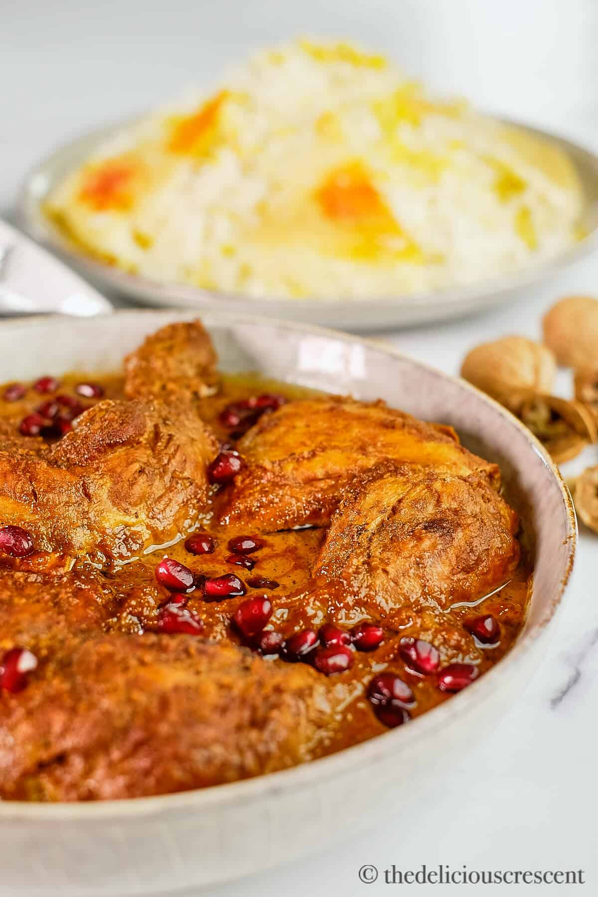 Persian chicken stew with pomegranate walnut sauce with rice.