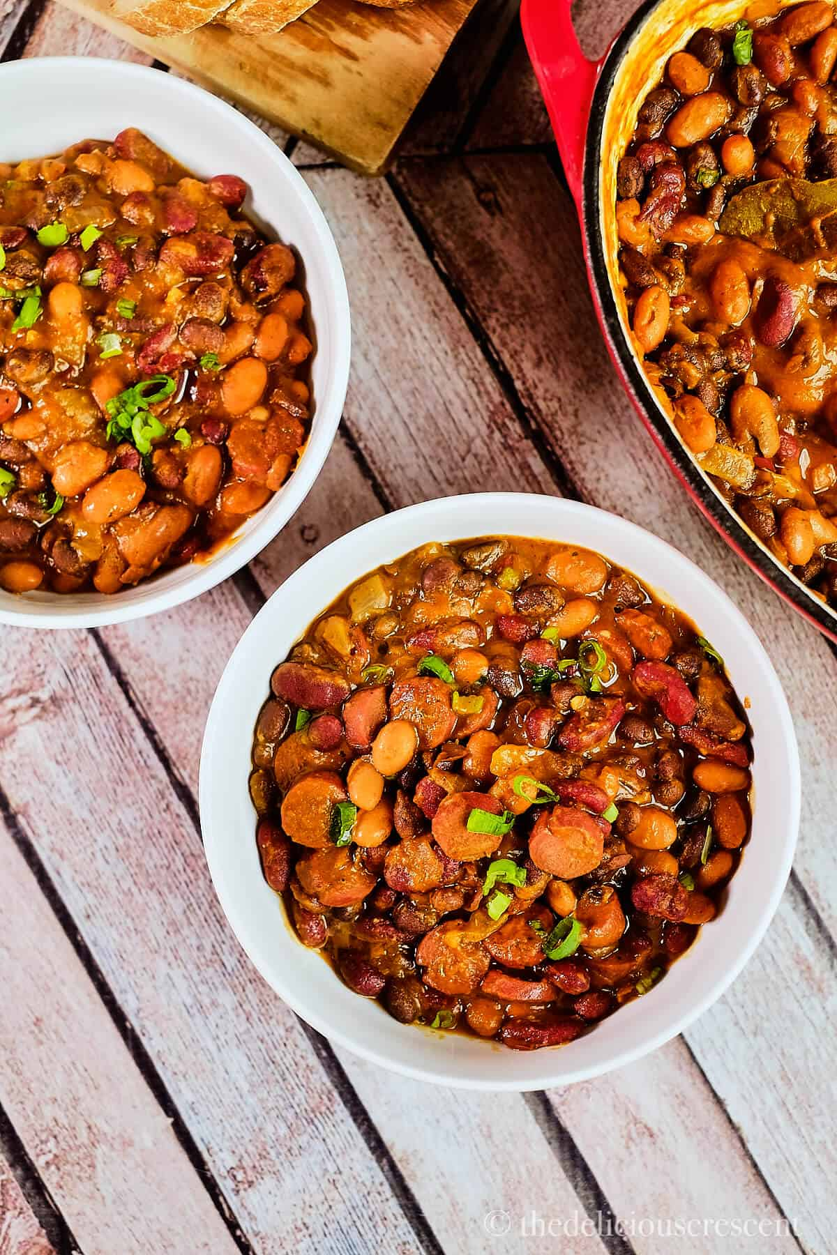 Bowls full of sausage stew with beans.